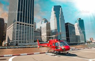 современный красный вертолет