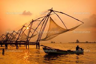 закат над китайскими рыболовными сетями